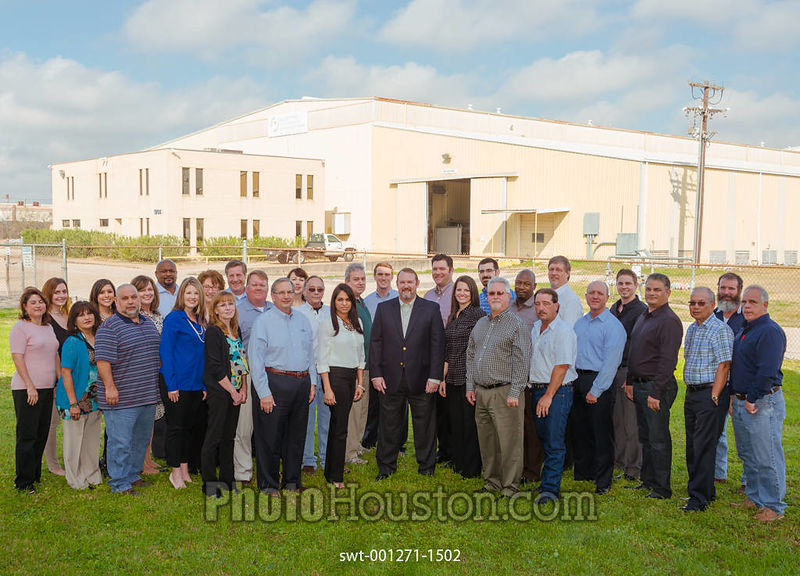 Group portrait of staff at manufacturing company