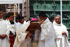 Bishop of Puno Jorge Carrion Pablisch kissing bible after reading from it during central mass, Virgen de la Candelaria festiv...