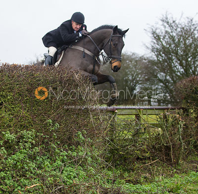 Philip Johnson jumping near the new Jubilee Covert - Cottesmore Hunt at Deane Bank Farm 4/12/12