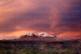 Aerial view of Putre at sunset, Nevados de Putre / Taapaca volcano in background, Region XV, Chile