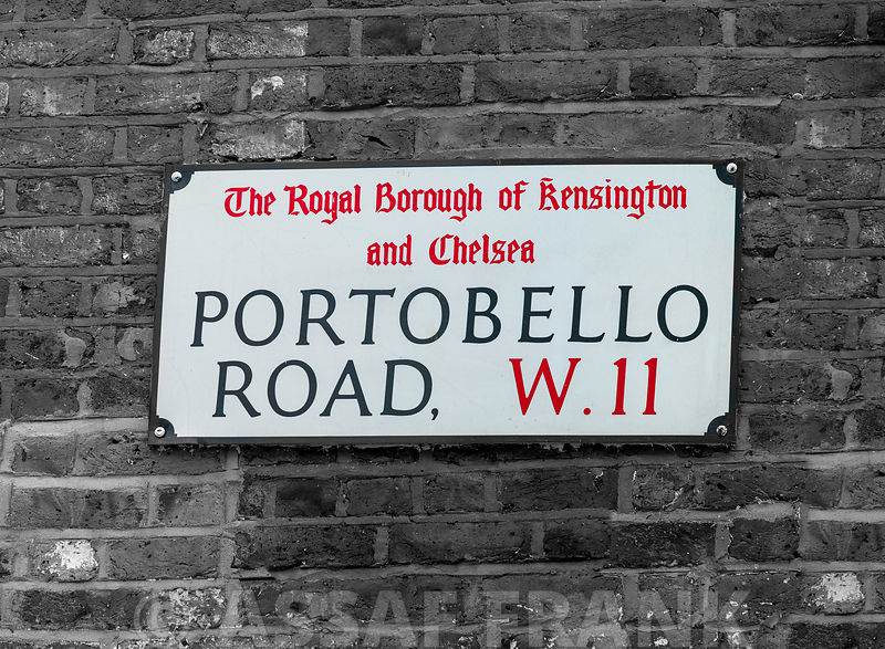 Portobello road sign board on a brick wall, London, UK