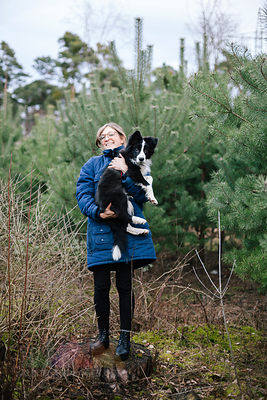 Germany, woman with Border Collie