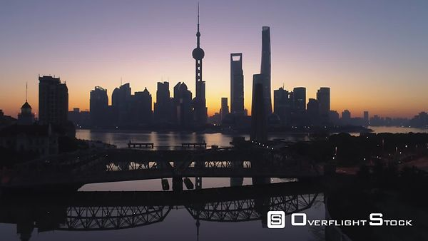 Panoramic Shanghai Skyline at Dawn. Lujiazui Financial District and Huangpu River. China. Aerial View. Drone is Flying Upward...