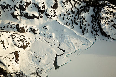 River Connecting to a Frozen Lake in the Mountains of British Columbia