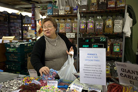 UK - Scunthorpe - Gillian Nottingham at work on Barney's sweet stall in  Scunthorpe Market