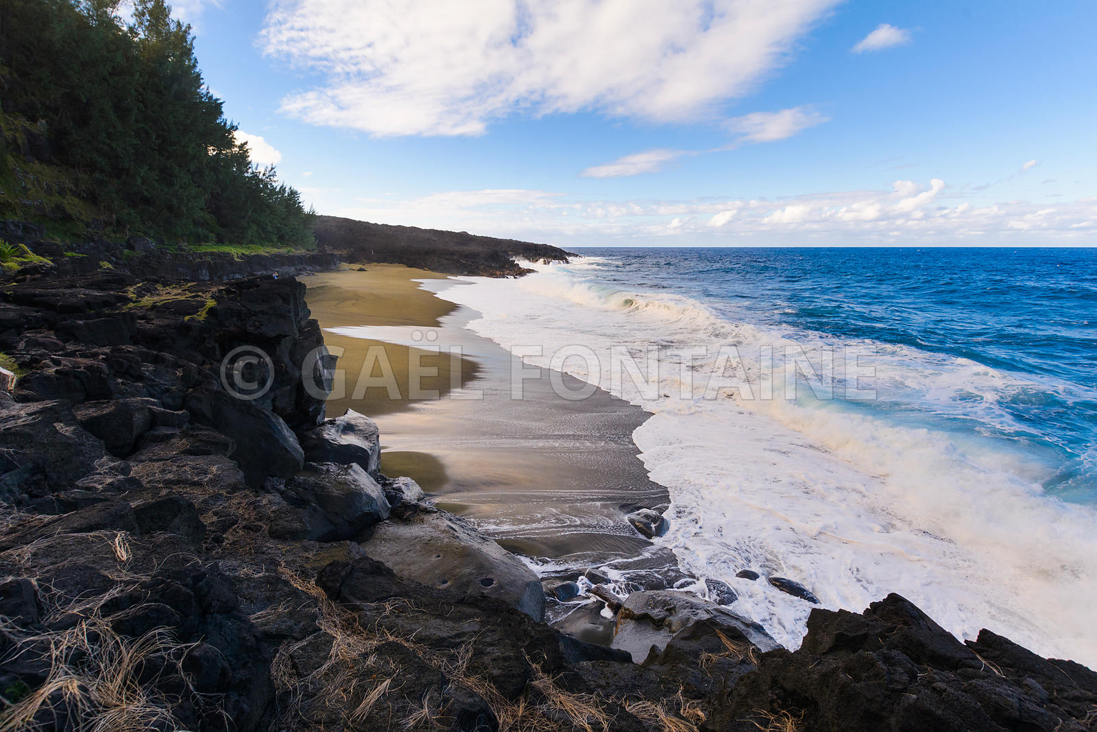 Wild beach with volcanic rocks at Reunion Island