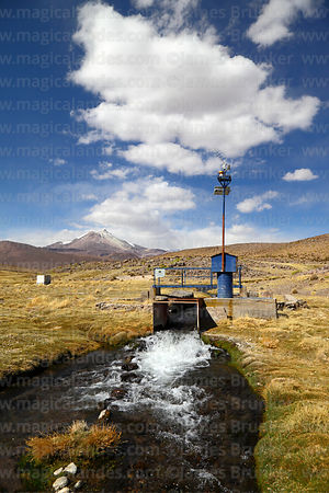 Solar powered gauge measuring flow of River Guallatiri, Guallatiri volcano in background, Las Vicuñas National Reserve, Regio...