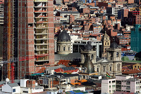 View of city centre and new government palace (L) under construction next to cathedral, Killi Killi viewpoint, La Paz , Bolivia