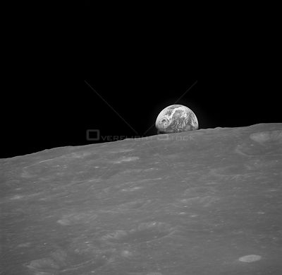 AS08-13-2329 (Dec. 1968) --- The Earth rising is about five degrees above the lunar horizon in this black and white telephoto...
