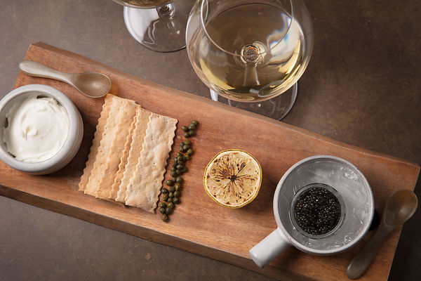 Wine and food pairing featuring chardonnay and caviar tasting