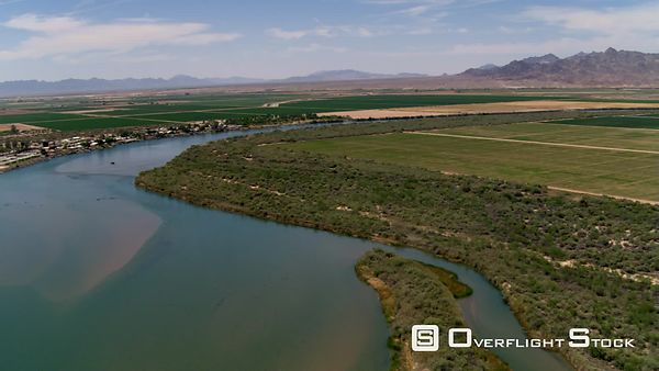 Flight above the Colorado River and a riverside community near agricultural land