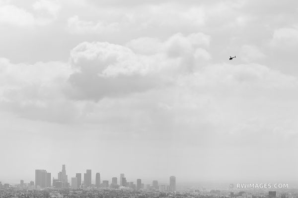 LOS ANGELES SKYLINE WITH SMOG AND HELICOPTER BLACK AND WHITE