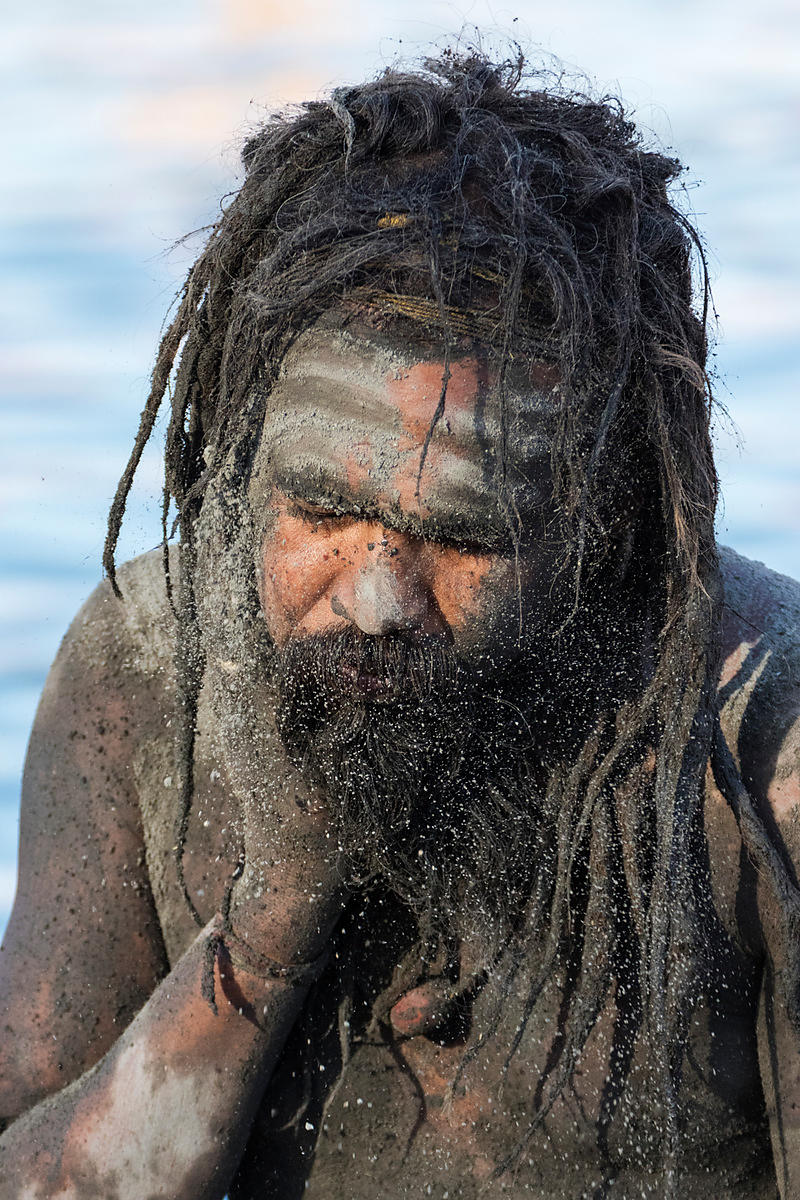 A Naga Sadhu Applies Ash to his Body after a Holy Dip in the Shipra River