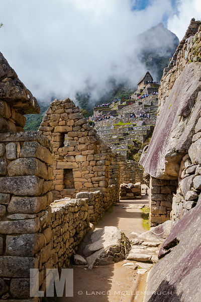 Walkway through Inca village at Machu Picchu