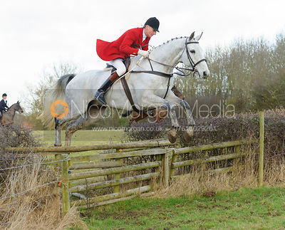 Joss Hanbury jumping a hedge with the The Belvoir Hounds at Ingarsby Hall 3/2