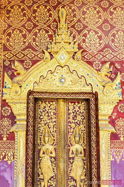Laos, Luang Prabang. Detail of decorations of temple