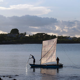 Fishermen bringing their boats home. Praio Milao, Sao Tome