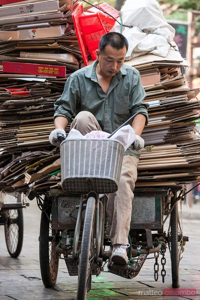 Man carrying an heavy load with his bicycle