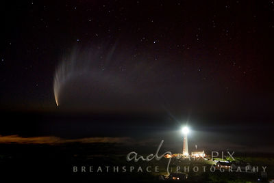 View over the sea of Comet McNaught and Slangkop Lighthouse in foreground
