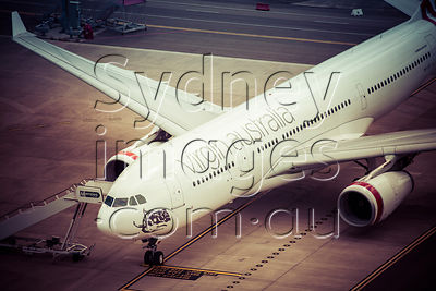 VH-XFC at Sydney Airport
