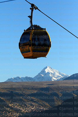 Yellow Line cable car gondolas above Mt Huayna Potosí and outskirts of  La Paz, Bolivia