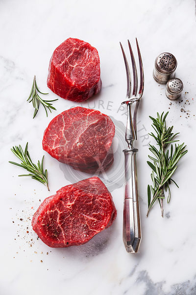 Raw fresh marbled meat Steak and and meat fork on white marble background