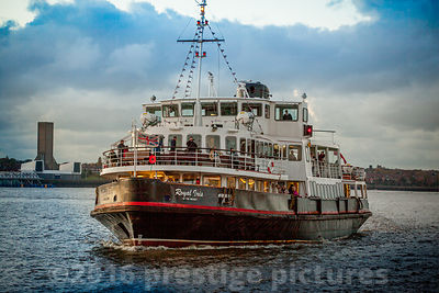 The Royal Iris of the Mersey Ferry on the Water at Dusk