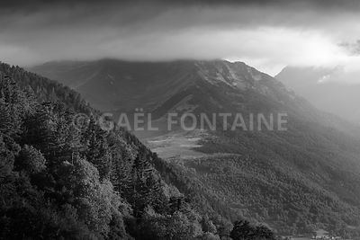Peak of Pyrenean mountains with clouds, France