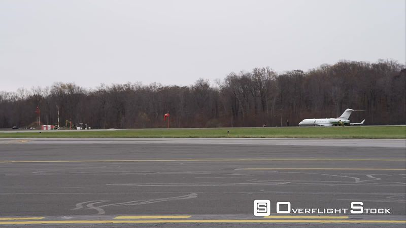 Planes on Runway at Westchester County Airport in Greenwich, Connecticut. Shot in November
