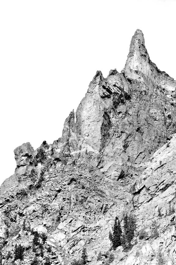 CLOSE UP OF ROCKY SPIRE DRAGON'S TAIL COULOIR ROCKY MOUNTAIN NATIONAL PARK COLORADO BLACK AND WHITE VERTICAL