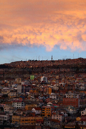 Dramatic Mammatus clouds over houses of suburb of La Paz at sunset,  looking towards Ciudad Satelite in El Alto, Bolivia