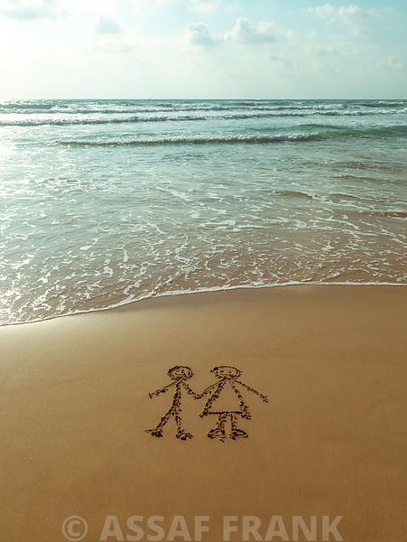 Couple drawn on sand at the beach