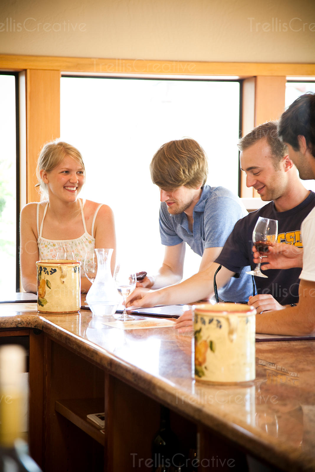 Friends enjoying tasting wine in tasting room