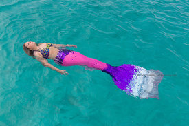 Mermaid Nicole Kozikowski floating around the boat during Mermaid Portfolio Workshop, Exuma Cays, Bahamas Islands