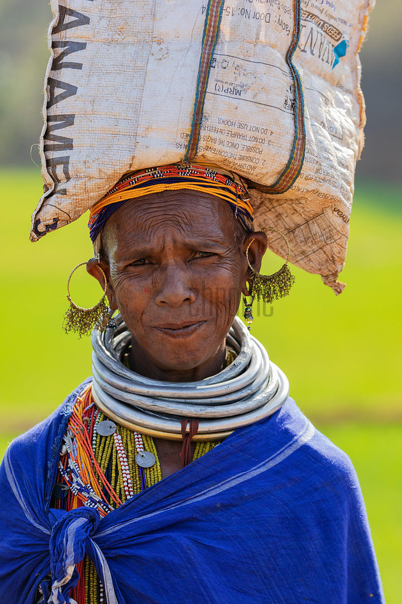 Portrait of a Woman from the Bonda Tribe Carrying a Bag of Grain on her Head