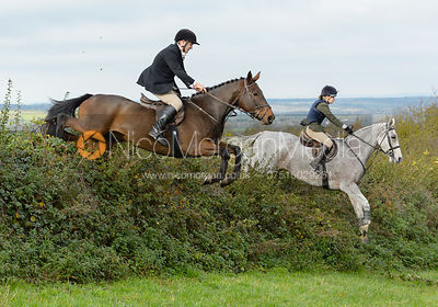 Mark Chatterton and Ella Burtt jumping a hedge above Clawson Thorns