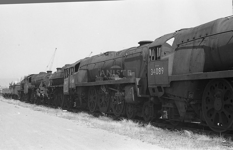 BB Class No 34060 in a line of locos in a siding at Newport waiting to enter Cashmores scrapyard  22/08/1968