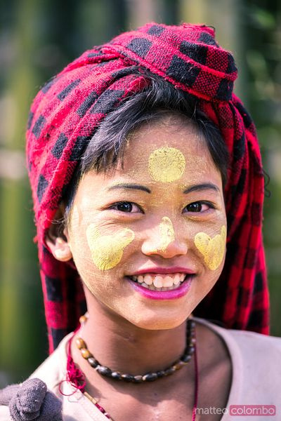 Portrait of young girl with traditional thanaka, Myanmar