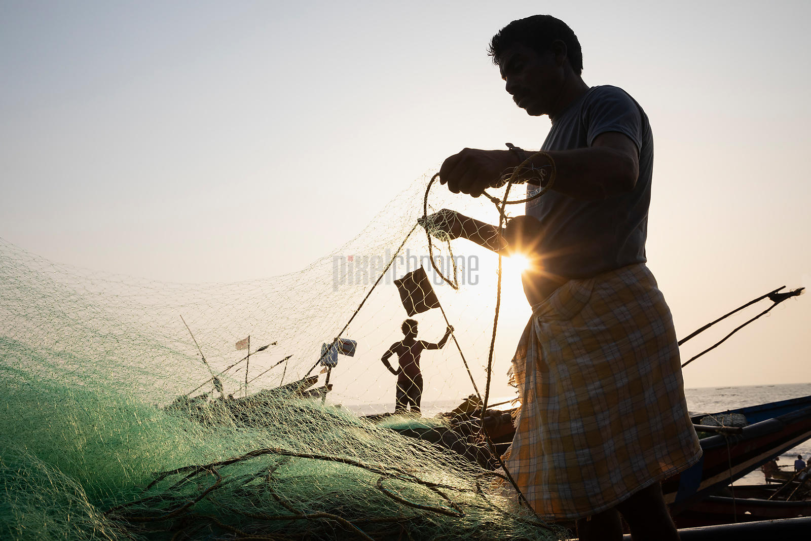 Checking the Nets on the Fishing Beach at Puri