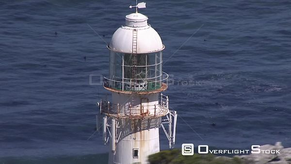 Aerial shot of Slangkop Lighthouse on Kommetjie Bay in Cape Town. Cape Town Western Cape South Africa