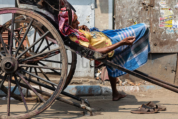 Portrait of an Exhausted Rickshaw Driver