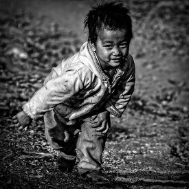 Young Hmong Village Boy Running in the Mud