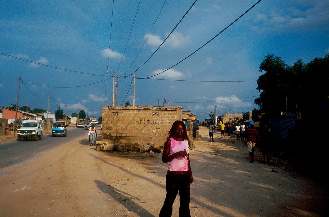 Angola - Luanda - A woman walks through the slum area of Prenda.