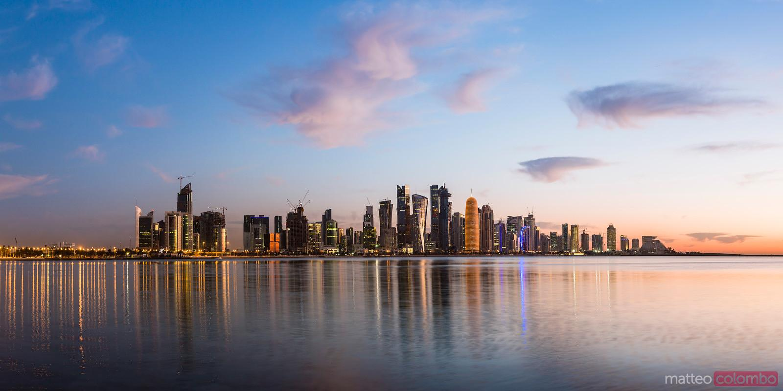 Matteo Colombo Travel Photography   Qatar, Doha. Cityscape at sunrise from  the Corniche   Stock photo for license and print