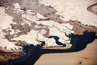 Tailings pond at the Syncrude mine north of Fort McMurray, Alberta, Canada. Tailings ponds in the tar sands are unlined and l...