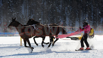 Valeria Holinger at the White Turf Skikjoering Race on Skis behind a horse on the frozen lake of Saint Moritz.