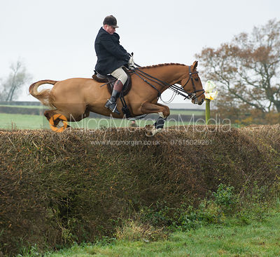Mark Halford jumping a big hedge
