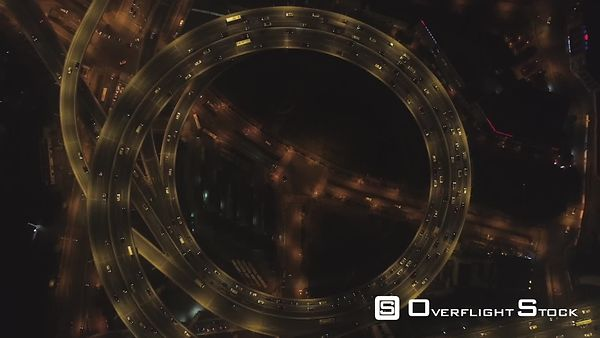 Spiral Illuminated Elevated Nanpu Highway at Night. Shanghai, China. Aerial Vertical View. Drone is Hovering and Spinning Aro...