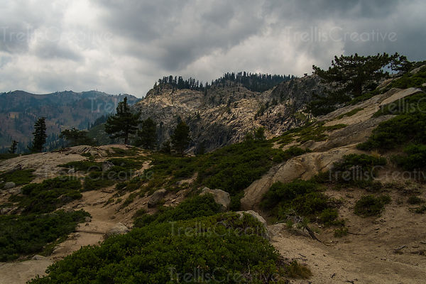 Storm clouds over mountain trail
