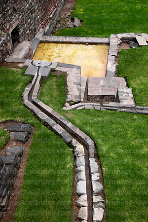 Inca water / drainage channels on lawn in front of the Coricancha / Sun Temple, Cusco, Peru